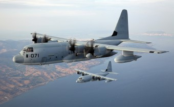 A pair of KC-130J Hercules with Special Purpose Marine Air-Ground Task Force Crisis Response conduct a formation flight Aug. 22, 2013, prior to performing night tiltrotor air-to-air refueling with SP-MAGTF Crisis Response MV-22B Ospreys near the southern coast of Spain. The Marines and sailors of SP-MAGTF Crisis Response provide a limited-defense crisis response capability in support of U.S. and partner-nation security interests within their area of responsibility and also participate in training events with regional partners. The unit is temporarily postured in Spain. (U.S Marine Corps photo by Cpl. Michael Petersheim)